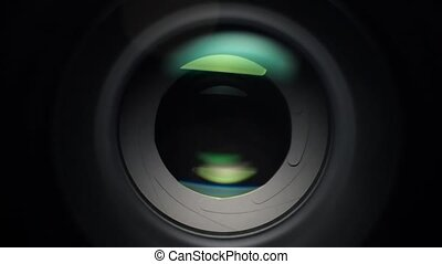 Focusing camera lens with aperture - A close up shot of a...
