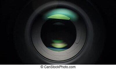 Focusing camera lens with aperture - A close up shot of a...