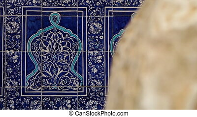 Focusing on a blue patterned tiles in Xiva - A medium, shot,...