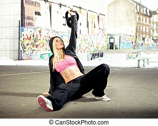 Focusing on lifting weight - Young adult fitness woman ...