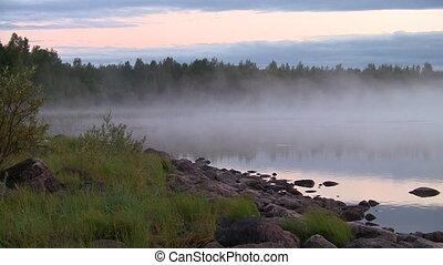 fog and ripples on a lake, loop