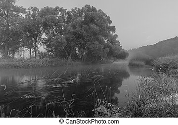 Fog at dusk on the river in the early morning