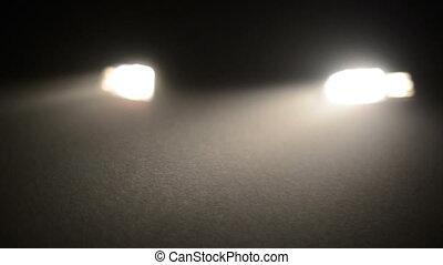 Fog in the headlights of car