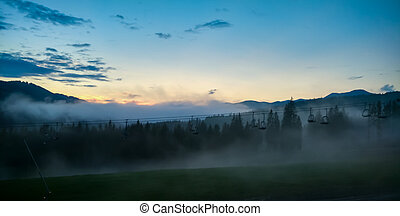 fog in the mountains at sunrise