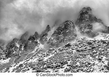 Fog in top of the rocky peaks