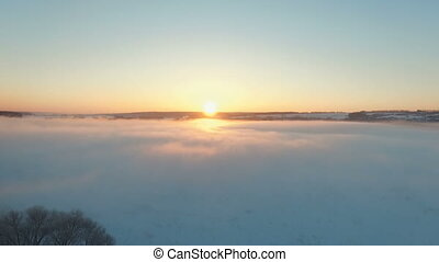 Fog in winter over the frozen river