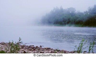 Fog on a river in summer morning