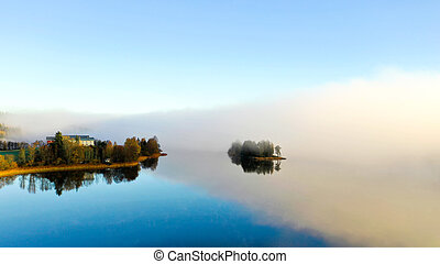 Fog on lake in Autumn