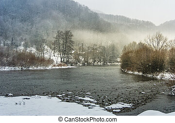 fog on the river in winter countryside. gloomy overcast...