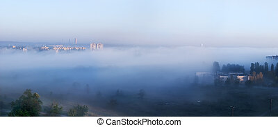 Fog over city. Panorama