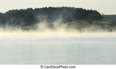 Fog over lake or river in summer - Scenic landscape with fog...
