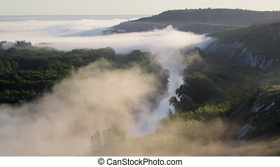 Fog over river and hills - Fog quickly moves over river and...