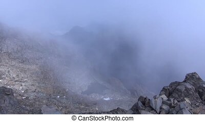 Fog over the mountain peaks