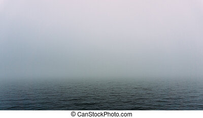 Fog over the water of the lake in autumn day. Abstract background image