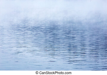 fog over water abstract background with selective focus and shallow depth of field