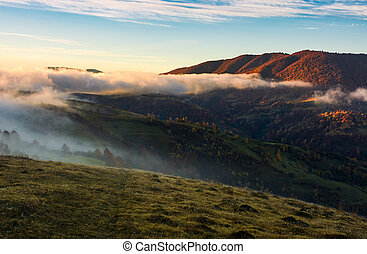 fog rolling over the hills at sunrise. stunning countryside...