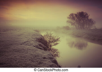 Foggy autumn morning on the river. Retro style.
