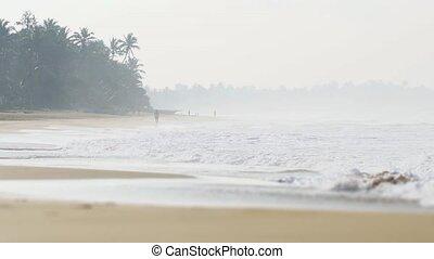 Foggy Day on a Popular Sri Lankan Beach. FullHD footage
