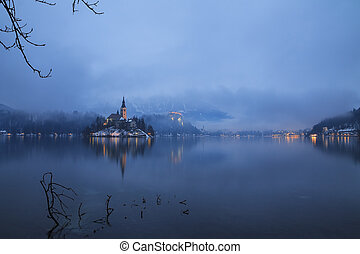 Foggy evening on Bled lake in Slovenia
