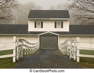 This is a shot of a foggy farmhouse on a horse farm in New Jersey.
