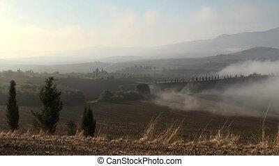 Foggy landscape pan
