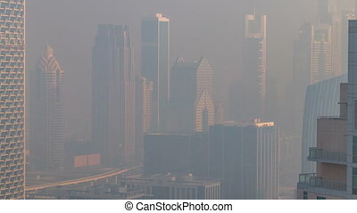 Foggy morning in downtown of Dubai timelapse. Futuristic...