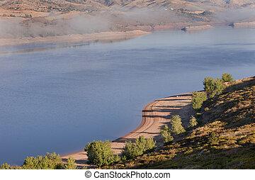 foggy morning on mountain lake