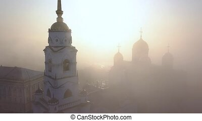 Foggy morning over the Assumption Cathedral in Vladimir. Clouds of fog fly over the cathedral. Bird's eye view.