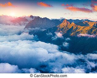 Foggy morning scene in the Val di Fassa valley