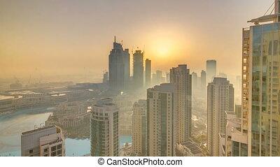 Foggy morning sunrise in downtown of Dubai timelapse.