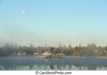 Foggy Morning With Full Moon on Lake
