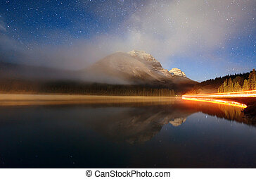 Foggy mountain at night