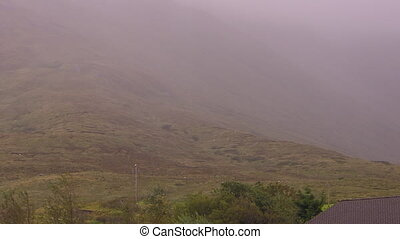 Foggy mountain in Ireland - A scenic foggy shot of a...