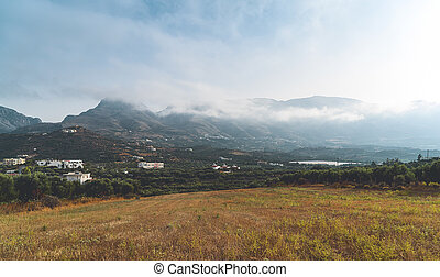 Foggy mountains and fields on Crete