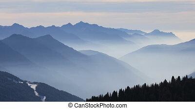 Foggy mountains in winter, Dolomite Alps in Madonna di...