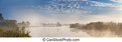 Foggy river in the autumn morning