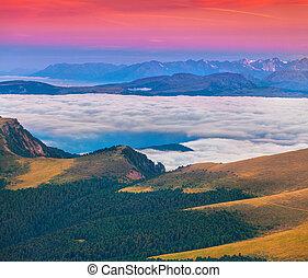 Foggy summer sunrise in the Italian Alps. Dolomites mountains, I