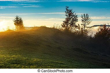 foggy sunrise in mountainous countryside. beautiful autumn...