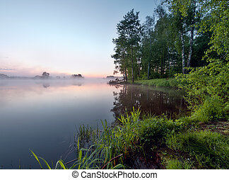 Foggy sunrise on a lake