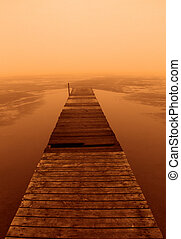 foggy sunset on the boardwalk