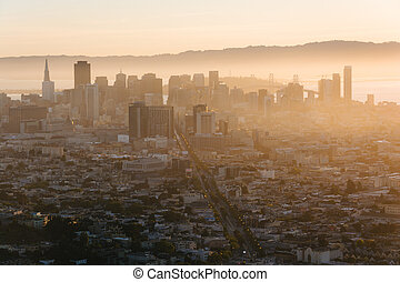 Foggy view of downtown at sunrise from Twin Peaks, in San Francisco, California.