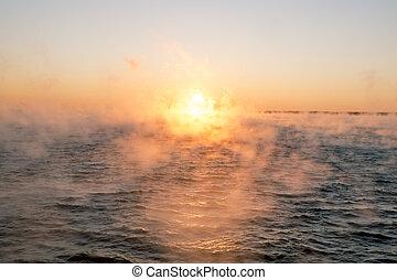 Foggy winter sunrise over a cold Baltic sea