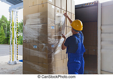 Foil on the packages - Foil putting on the boxes by a...