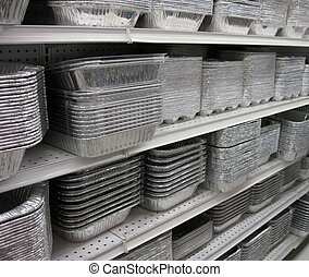 Foil Pans - Shelves filled with a selection of square, foil...