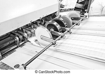 Folding machine working in printing industry