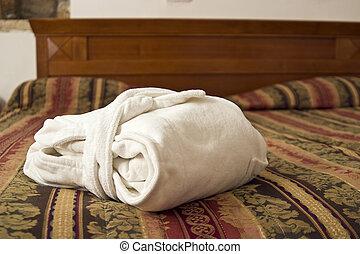 bath robe - folded bath robe on a bed