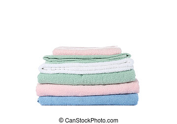Folded color towels isolated on white background