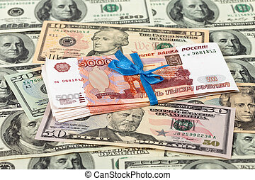 Folded five thousandths rouble bills on dollars background