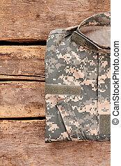 Folded khaki military camouflage uniform.