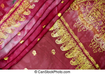Folded Magenta Pink Indian Sari with Gold Paisley Pattern Border